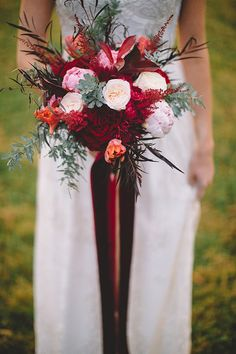 This red, white and green wedding bouquet designed by DBI Designs with cascading velvet ribbons is ever so lovely, and so fitting for Valentine's Day.