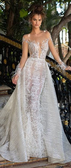 BERTA Wedding Dresses | Fitted wedding dress illusion plunging sweetheart neckline bridal gown | Cold shoulder embellished bridal dress with sleeves | Feathers overskirt wedding gown #weddingdress #weddingdresses #bridalgown #bridal #bridalgowns #weddinggown #bridetobe #weddings #bride #weddinginspiration #dreamdress #fashionista #weddingideas #bridalcollection #bridaldress #fashion #bellethemagazine #ido #dress See more gorgeous bridal gowns by clicking on the photo