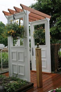 DIY from old doors - looks like they just used rafter hangers to attach the top portion - w/be much easier that way
