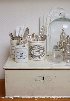 http://mylittlewhitehomebynadine.blogspot.nl/ I do like this blog, in Dutch. Such a pretty set of pictures, too. This is my liking in storage and display.