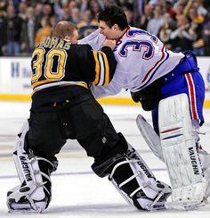 Montreal Canadiens goalie Carey Price (31) fights with Boston Bruins goalie Tim Thomas