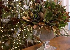 Magnolia leaves with their dual coloration are a beautiful display in a silver vase. Christmas Mood, Outdoor Christmas, Rustic Christmas, Christmas Wreaths, Christmas 2016, Xmas, Tree Decorations, Christmas Decorations, Holiday Decorating