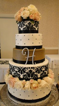 5 tiered black white and latte damask wedding cake with fresh roses
