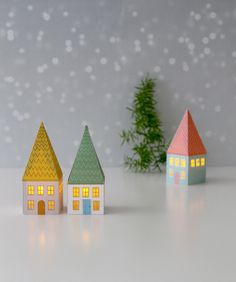 Printable Paper House Luminaries Another fun & free printable paper craft! A set of mini paper houses glowing with LED candle lights! Make a Christmas village or use as ornaments! Diy Paper Christmas Tree, Christmas Holidays, Christmas Crafts, Christmas Decorations, Christmas Ornaments, Christmas Trees, Christmas Staircase, Paper Ornaments, Outdoor Decorations