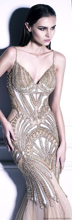 Dany Tabet Couture Can you say, WOW... This is so beautiful. Kudos to the designers and the model for wearing it so well.