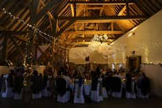 Fantastic lighting in the tithe barn at Ufton Court. Star fairy light canopy and lanterns in the barn by Oakwood Events for a spring wedding