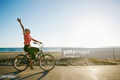 Stock-Foto : Caucasian woman riding bicycle near beach
