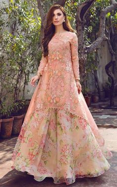 Peach Floral Kurta Lehenga is part of Kurta lehenga - Peach Floral Kurta Lehenga Threads and Motifs is a Pakistani Online Website that does pretty budget lehengas and occasional wear Party Wear Indian Dresses, Designer Party Wear Dresses, Pakistani Dresses Casual, Indian Gowns Dresses, Indian Bridal Outfits, Pakistani Bridal Dresses, Dress Indian Style, Indian Fashion Dresses, Pakistani Dress Design