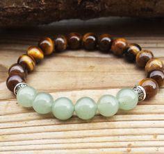 Check out this item in my Etsy shop https://www.etsy.com/uk/listing/221632983/on-sale-aventurine-tigereye-mala