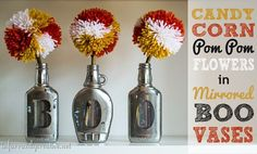 Halloween Decor Ideas   Looking for fun yet inexpensive Halloween decor? It doesn't get more budget-friendly than upcycled glass jar vases and candy corn pom pom flowers!