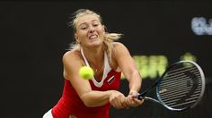 Maria Sharapova of Russia returns a shot against Laura Robson of Great Britain during the second round of Women's Singles Tennis on Day 4 of the London 2012 Olympic Games at Wimbledon on 31 July