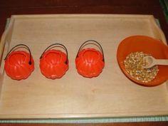 Spooning Corn Kernals into Pumpkins - Halloween/fall activity