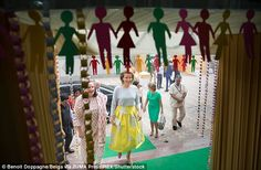 Queen Mathilde looked stylish in an eye-catching yellow A-line skirt that flattered her fi...