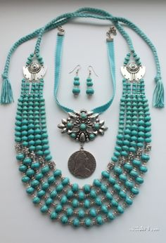 Traditional Ukrainian turquoise bead necklace (namysto) with a dukach (a large coin pendant)