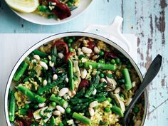 Spring-Vegetable Paella | Food & Wine goes way beyond mere eating and drinking. We're on a mission to find the most exciting places, new experiences, emerging trends and sensations.
