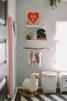 Love the idea of making a little clothing rack out of a twig. That rug is divine. Such a nice soothing space.