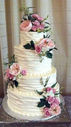 Rustic buttercream and flowers wedding cake