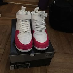 Girls AJF12. (GS) Jordans White and cherry pink Jordans. Never worn!!!! If you wear a size 8 in women's, you can fit a size 6 youth. Jordan Shoes Sneakers