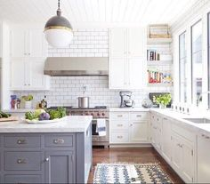This is THE kitchen! Love the orientation/windows/gray/subway tile with gray grout/cabinets to ceiling plus open shelving/wood floors/hardware; the ceiling panels, brightness, colors. Basically all of it:).
