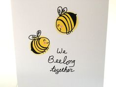 "Hello! Thank you for looking around! This listing is for one (1) ""We Beelong together,"" Sweet Heart Bee Valentine's Day Card  Who doesn't love doodles, puns, bees and love?! Super cute, perfect card for all children, teens, men and women :0)  The front depicts my doodle of two happy bees, and reads, ""we beelong together"" and they each have little clear sparkles on their wings :) The inside reads, ""I love you!  The colors are yellow, black, white and light pink for their happy cheeks…"