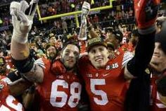 Ohio State's Taylor Decker and Jeff Heuerman celebrate after the NCAA college football playoff championship (AP Photo/David J. Phillip)