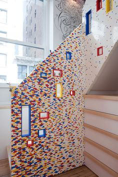 A staircase with a unique railing made of nearly 20,000 LEGO blocks!