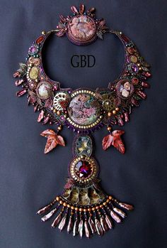 Beautiful jewelry with carved stones | Beads Magic.  This necklace is by Guzel Bakeeva.