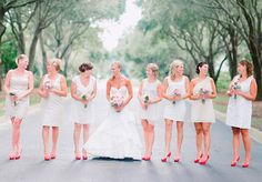 I love the colour of the bridesmaids dresses and red shoes <3