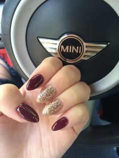 Burgundy and gold almond shaped nails