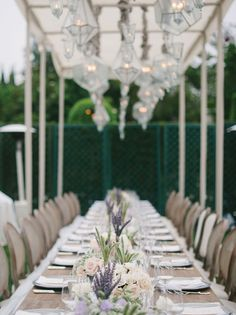 The 36-person head table lined with wildflowers, lavender, roses, wheat grass, Queen Anne's lace and scabiosa pods. #weddings