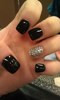 All black nails with Swarovski accent nail. My girl does amazing 3D nail art-you can't see it in the pic, but the accent nail sparkles like crazy!!