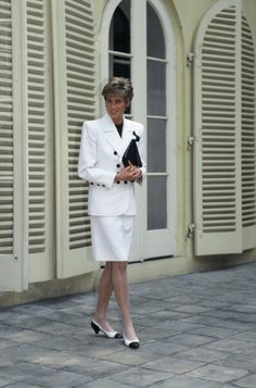 Diana Princess of Wales wears a white suit with black buttons during a visit to Prague on May 01 1991 in Prague Czech Republic