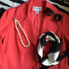 Coral trench coat with polka dot lining Slit in the back, side pockets, feminine but playful with the polka dots discretely peaking out. Jackets & Coats Trench Coats