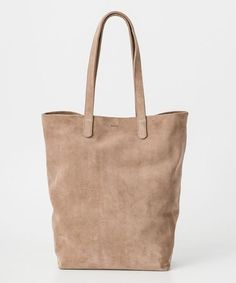 """The ultimate bag """"best friend""""! Carry this Basic Tote in Dune Suede with you everywhere, it's up for anything! A simple, polished tote, in the softest suede. Durable, but totally stylish. 15 in. H x 1"""