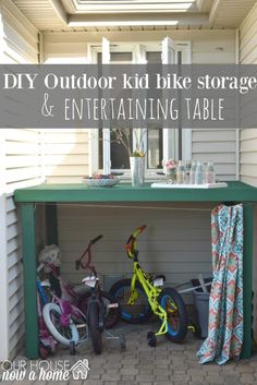 DIY outdoor bike storage, how to hide outdoor kids toys with this simple DIY project. Using 2x4's and a shower curtain, you can add a space to set for or drinks when entertaining. Also hiding and organizing the kids bikes and other outdoor toys. To see the full tutorial click the link or visit- http://ourhousenowahome.com/