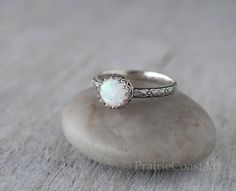 Beautiful flashes of color in this simulated Opal Ring in Sterling Silver, handforged band and set in a sterling crown setting.    ● 8mm