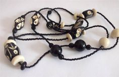 VINTAGE 20 S DECO BLACK CREAM CARVED CELLULOID LAMINATED NECKLACE FLAPPER BEADS