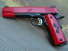 """""""Deadpool gun"""" let me just say that I did not say this the person who pinned it before me did and if they think that this is a freaking dead pool gun then they're a freaking idiot cause I think it's pretty obvious it's a Harley Quinn gun Weapons Guns, Guns And Ammo, Armas Ninja, Custom Guns, Custom 1911, Cool Guns, Awesome Guns, Fantasy Weapons, Joker And Harley Quinn"""