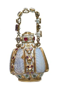 Tudor-era fragrance bottle, 16th or 17th c. Carved panels of opaline chalcedony with rubies, spinels, diamonds and gold. Part of the Cheapside Hoard discovered in 1912. (Museum of London.)