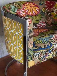 Vintage tub chair recovered in eclectic patterns. Coolest chair ever.