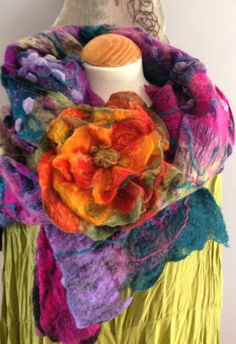 Really fun and quirky hand felted wool and cotton 3 layer flower corsage. I do many colours and sizes of these - This one is a beautiful oversized piece with oranges and greens.....highly textured with a beaded centre, it is definately an eye catcher and looks great against a block colour - maybe the collar of a jacket but also as a fastening for some of my scarves. Sure to brighten up any outfit! It measures a substantial 21cm (8) across at its widest diameter    I am a small one woman…