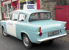 Old Ford Anglia used as an early British Police car