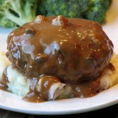 Slow Cooker Salisbury Steak..  IT IS AWESOME  --       Uses dry onion soup mix, Packet of beef broth, Italian seasoned bread crumbs, cream of chicken soup.