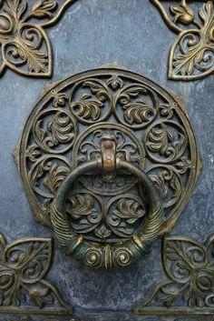 Bronze knocker on the church door Stock Photo