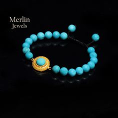 3.8 g 18K Gold  Genuine Turquoise Beads, bead size 8 mm  This is a beautiful bracelet. Turquoise stone is a stone of protection, strong and opaque, yet soothing to the touch, healing to the eye, as if carved from an azure heaven and slipped to earth as said by ancients.