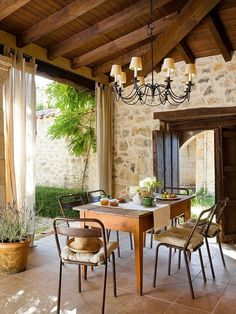 Simple and rustic covered outdoor dining room.
