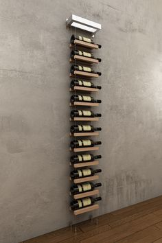 Modern and minimalistic wall hanging cable wine rack for 12 bottles from Buoyant Wine Storage LLC. Hanging Wine Rack, Wine Rack Wall, Wine Wall, Wine Rack Design, Wine Cellar Design, Wine Shelves, Wine Storage, Merci Store, Cable Inox