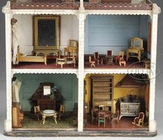 Turn of the century [two-story wood] dollhouse. Very charming [unattributed] house has two removable front panels that open to reveal four rooms, each having a window. The interior includes many hand-carved details, such as a stove hood and a pass-through window from the kitchen. The exterior of the house is carved to simulate brick and has elegant hand-carved window trim. The rooftop holds a gazebo. House is accompanied by a large lot of furnishings including piano, beds, chair, hutch