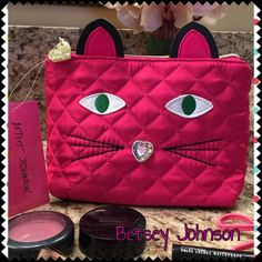 """Only one on Posh! Betsey Johnson Kitsch Kitty Carry your cosmetics in purr-fect style with this gorgeous Betsey pink kitty cosmetic case with its cute tail curling up the backside of the case! While you brighten your face with make-up, this will brighten your disposition!! Words of affirmation printed on the inside like You're Hot! Rock It! Sweet and more! Closure is gold zipper with a heart xox Betsey! 8""""L x 6""""H x 3 1/2"""" D No trades Betsey Johnson Bags Cosmetic Bags & Cases"""