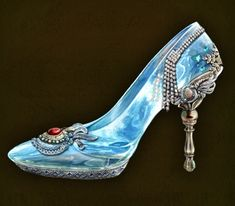 Glass Slippers are seen many times in the Dark Parables universe. We first encounter them in the second game, The Exiled Prince. They appear in many more games after that, usually relating to one or more Cinderellas. As the name would suggest, Glass Slippers are high heeled shoes made entirely out of glass. They usually have a blue or crystalline appearance and are decorated with gold and ornate designs. Of course, variations on this theme do exist.